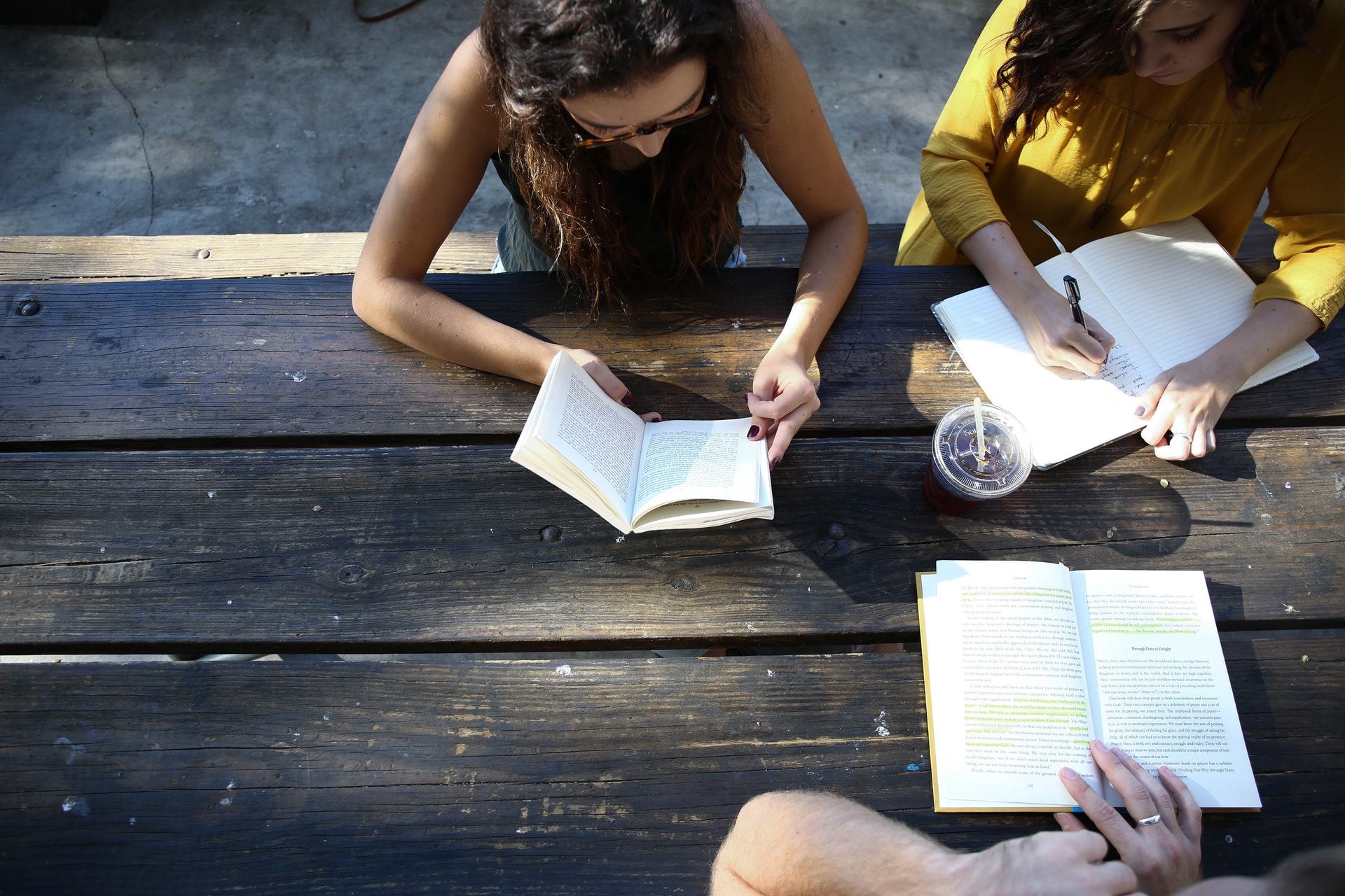 people reading and writing together