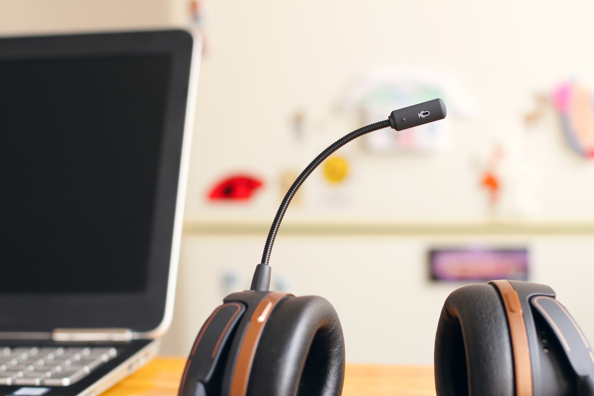 Headset with microphone and a computer in the background
