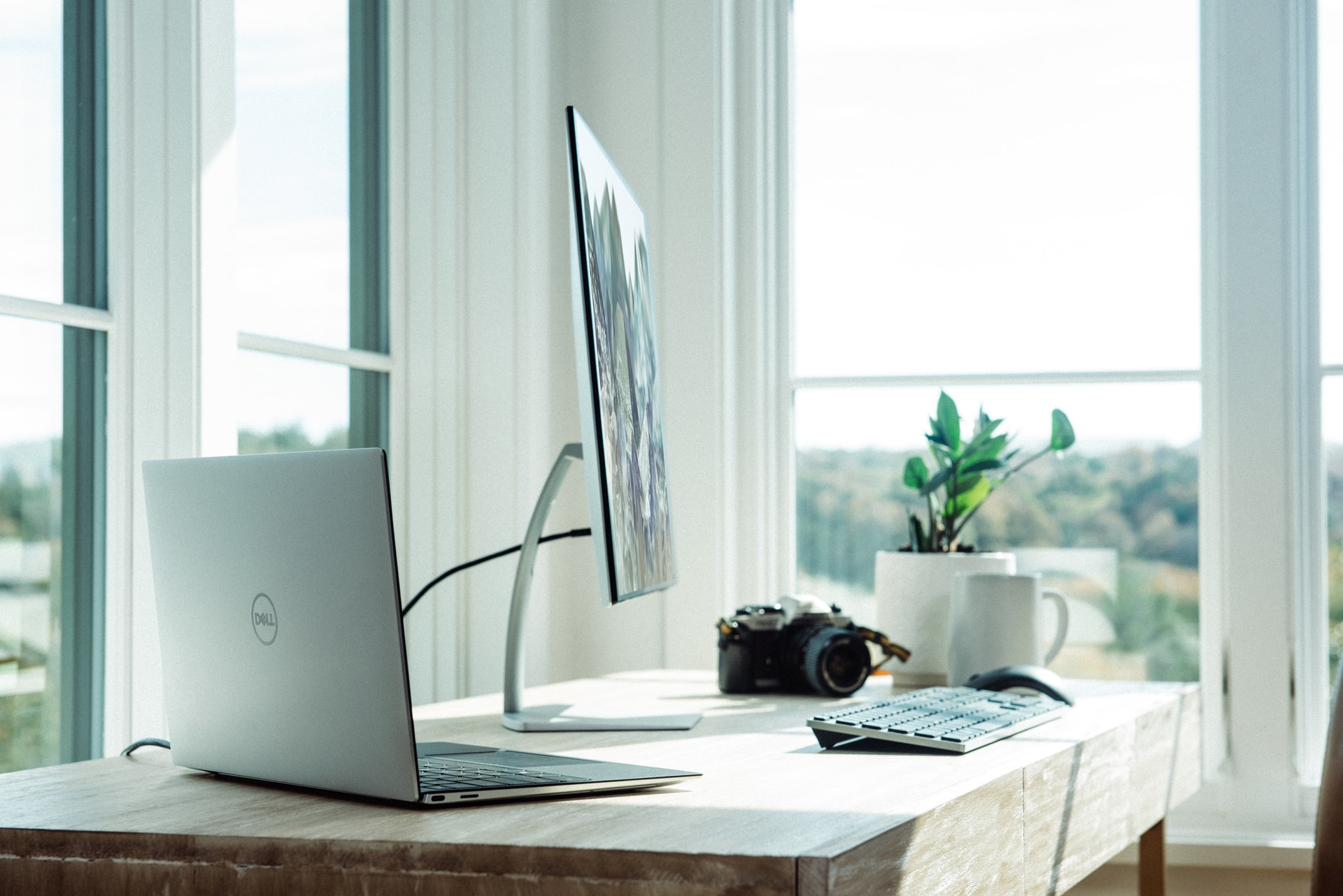 Remote working set up, including computer screen and laptop